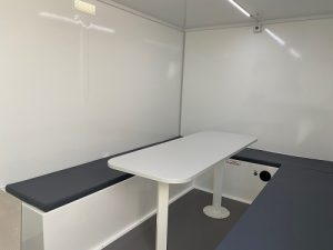 the interior of a welfare unit with communal seating area